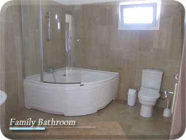 A Large Bathroom Having A White Suite Featuring A Corner Bath With Shower Ove